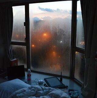 foggy window by a bedside on a rainy day