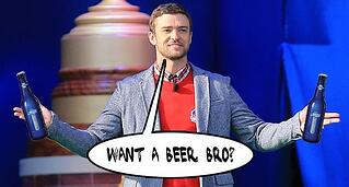 Justin Timberlake holding beers in each hand