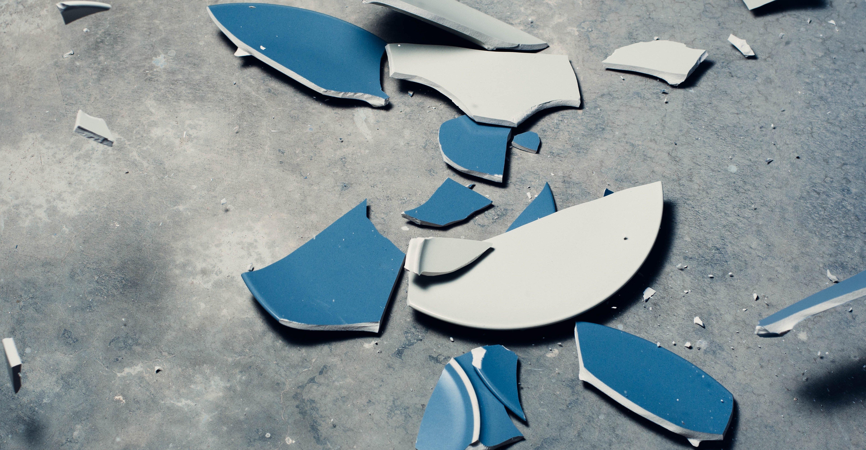 broken plate pieces on the floor
