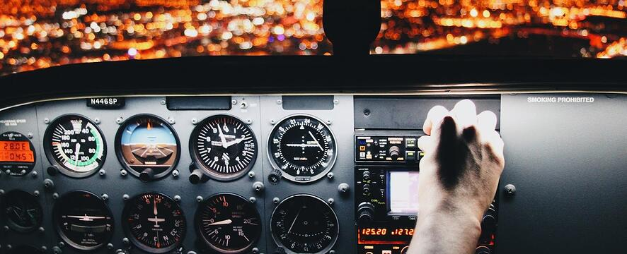 hand piloting a plane