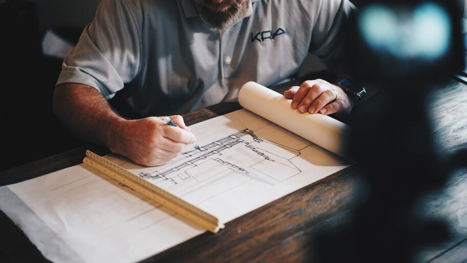 architect drawing a building plan