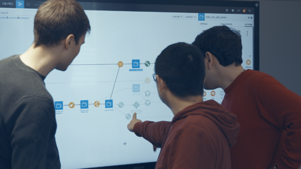 three men point to Dataiku DSS workflow on a screen