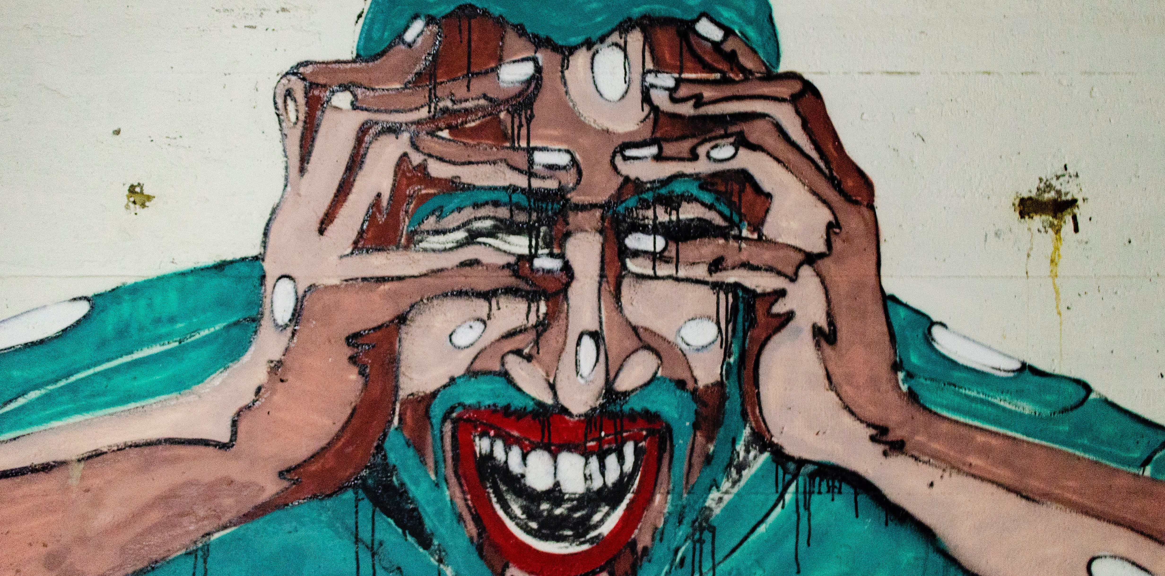 graffiti man holding his head in pain