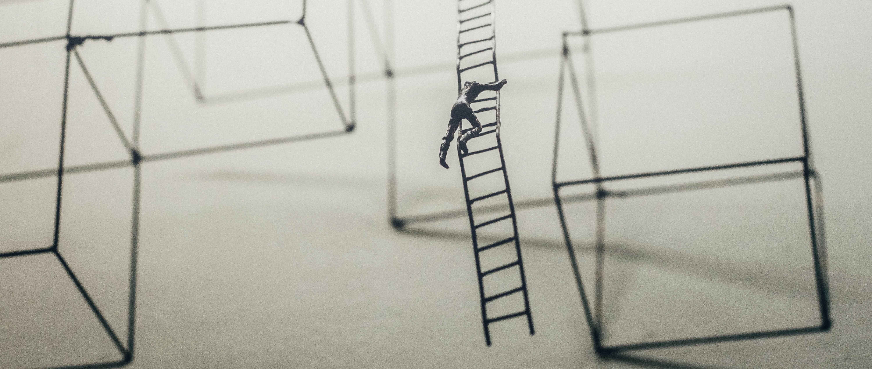 a man climbing a ladder