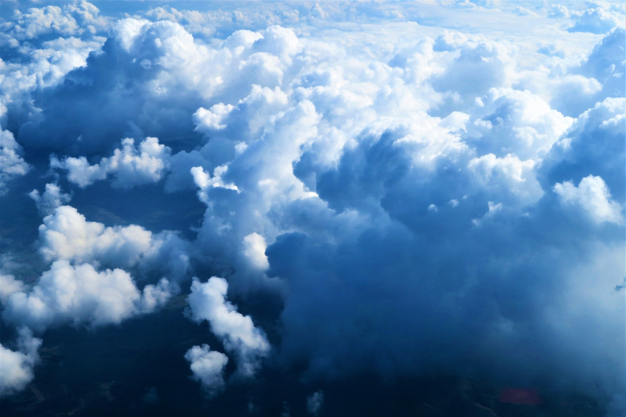 blue and white clouds seen from a bird eye's view