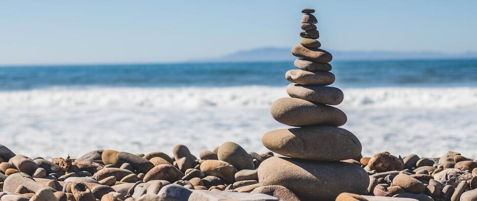 a pile of rocks in front of the ocean