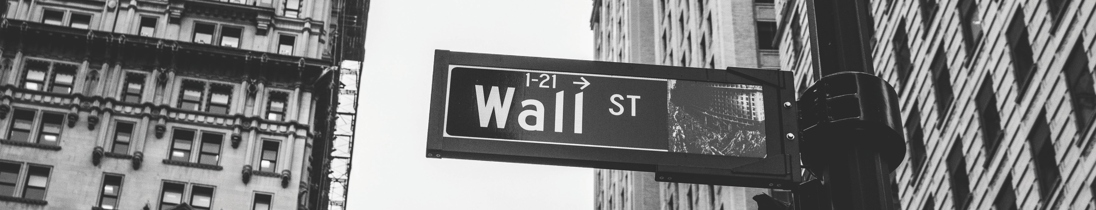 wall street black and white sign